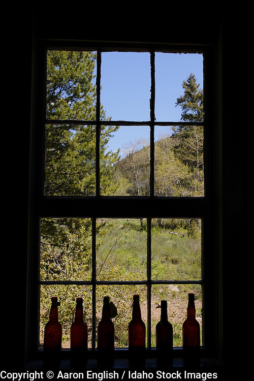 Old bottles sit in the window of an historic building in the historic town of Custer located in the Sawtooth Challis National Forest Idhao