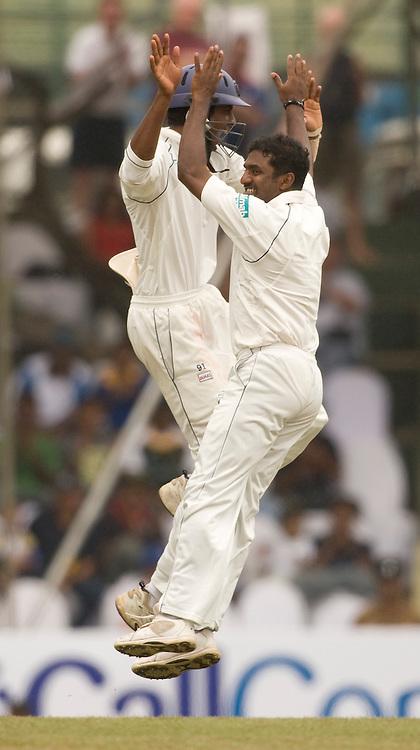 Muttiah Muralitharan celebrates the wicket of Ian Bell during the first Test Match between Sri Lanka and England at the Asgiriya Stadium, Kandy. Photograph © Graham Morris/cricketpix.com (Tel: +44 (0)20 8969 4192; Email: sales@cricketpix.com)