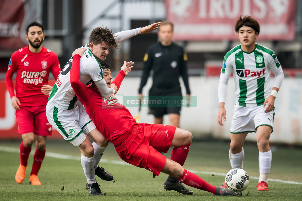 (L-R) Tom van de Looi of FC Groningen, Tom Boere of FC Twente, Ritsu Doan of FC Groningen during the Dutch Eredivisie match between FC Twente Enschede and FC Groningen at the Grolsch Veste on March 04, 2018 in Enschede, The Netherlands