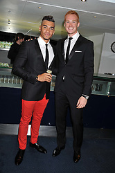 Left to right, gymnast LOUIS SMITH and Olypic Gold medal winner GREG RUTHERFORD at the GQ Men of The Year Awards 2012 held at The Royal Opera House, London on 4th September 2012.