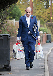 © Licensed to London News Pictures. 09/11/2017. Whitam, UK. Alex Sawyer, husband of Priti Patel, arrives home with two bags of shopping. Priti Patel resigned from government yesterday. Photo credit: Peter Macdiarmid/LNP