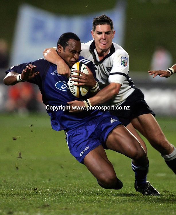 Joe Rokocoko is brought down by Jaques Fourie during the Rebel Sport Super 12 Round Seven match between the Blues and the Cats at North Harbour Stadium, Auckland, New Zealand on Saturday 9th April 2005. The Blues won the match, 23 - 6. Photo: Hannah Johnston/PHOTOSPORT