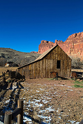 Horse stable and corral with sandstone rock formations in the background, Historic Fruita, Capitol Reef National Park, Utah, United States of America