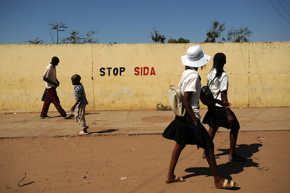 Information about HIV/AIDS is painted on walls to raise awareness outside a high school in Maputo, Mozambique.