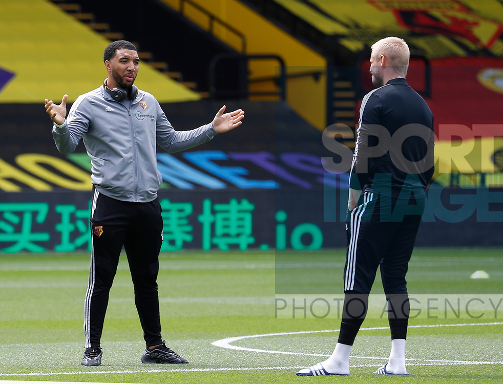 Troy Deeney of Watford talks to Kasper Schmeichel of Leicester City during the Premier League match at Vicarage Road, Watford. Picture date: 20th June 2020. Picture credit should read: Darren Staples/Sportimage