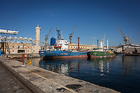 """PALERMO, ITALY - 6 JUNE 2016: (L-R) Cargo ship Munzur and fishing boat Ozu 2, seized respectively in December 2015 with 13 tons of hashish and in July 2015 with 5 tons of hashish within the """"Operazione Libeccio"""", are docked here in the harbor of Palermo, Italy, on June 6th 2016.<br /> <br /> Between January 2014 e December 2015 more than 120 tons of hashish, carried on fishing boats or cargo ships from Morocco to Libya, were seized in the Strait of Sicily by Italy's Guardia di Finanza (Financial Police) thanks to an international police investigation named """"Operazione Libeccio"""", carried out by the GICO (Gruppo Investigativo Criminalità Organizzata, Organised Crime Investigation Group), a unit of the tax police of Palermo under the supervision of the DDA (Direzione Distrettuale Antimafia) of Palermo.<br /> <br /> """"What is happening in Libya is same historical occurrence that happened years ago in Afghanistan. Such as the Talibans who financed their terroristic activities with heroin trafficking for the purchase of weapons, the Caliphate is proposing the same terroristic strategy by purchasing and commercialising hashish in order to purchase weapons used in their war"""" Sergio Barbera, Deputy General Prosecutor of Palermo, said."""