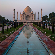 The Taj Mahal and its reflecting pool at sunrise, Agre, India.