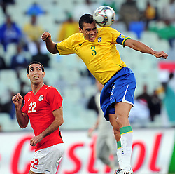 Lucio caption of Brazil head the ball during the third soccer match of the 2009 Confederations Cup between Brazil and Egypt played at Vodacom Park,Bloemfontein,South Africa on 15 June 2009.  Photo: Gerhard Steenkamp/Superimage Media.