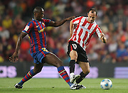 FC Barcelona's Toure Yaya (l) and Athletic de Bilbao's Joseba Etxeberria during the Supercup of Spain.August 23 2009.