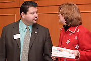 18516Appalachian Scholars Open House reception 12/10/07..Dave Garcia and Part Bungard......Appalachian Scholars program: A Q&A.Information session scheduled tonight.Dec. 10, 2007.By George Mauzy..The Athens campus will host its third annual Appalachian Scholars information session for high school students and parents at 7 p.m. today in the Baker University Center Ballroom. Organizers will outline the program's requirements and answer questions...In anticipation of tonight's event, Outlook asked Associate Provost for Appalachian Access and Enrichment Programs Richard Greenlee to share his thoughts about the program. But first, some background...The Appalachian Scholars award, now in its second year, is a need-based, renewable four-year scholarship award valued at $10,000 each year. It includes an annual book stipend and participation in a yearly leadership seminar...The university has 20 Appalachian Scholars on five campuses, including 12 on the Athens campus and two on each regional campus except Lancaster, which is not in one of Ohio's 29 Appalachian counties. This fall's class of 10 recipients was chosen from more than 150 applicants...Last year's Appalachian Scholars information session, the first large-scale public event held in the new University Center, attracted more than 200 people. A similar crowd is expected tonight...The Eastern campus will host its info session at 6 p.m. Wednesday in Shannon Hall. The Chillicothe and Southern campuses have already held their sessions, and one is expected to be scheduled on the Zanesville campus in January...Why is the Appalachian Scholars program important?..It demonstrates the university's commitment to families and communities in the 29-county region by helping high school students attain a college education...The program teaches students and their families how to navigate the educational experience. It promotes economical sustainability and social mobility by providing the students with an education and developing the