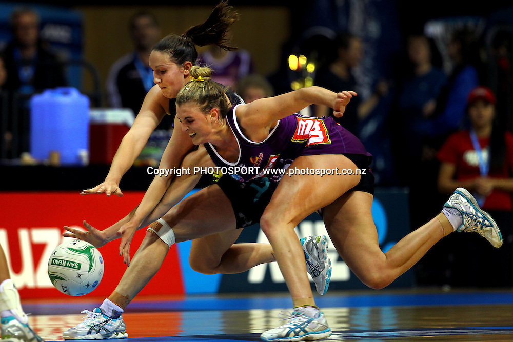 Magic's Khao Watts chases down the ball against Firebirds' Gabby Simpson. ANZ Netball Championship, Minor Semifinal, Waikato/Bay of Plenty Magic v Queensland Firebirds, Claudelands Arena, Hamilton, New Zealand. Sunday 30th June 2013. Photo: Anthony Au-Yeung / photosport.co.nz