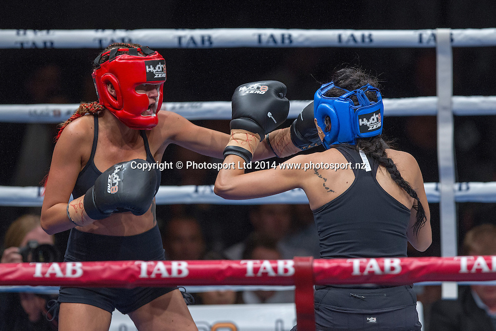 Jade Louise (The GC), left, fights DJ Tuini at the Hydr8 Zero Heavyweight Explosion, Vodafone Events Centre, Auckland, New Zealand, Saturday, July 05, 2014. Photo: David Rowland/Photosport