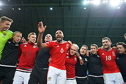 LILLE, FRANCE - Friday, July 1, 2016: Wales' captain Ashley Williams leads his team's celebrations after a 3-1 victory over Belgium and reaching the Semi-Final during the UEFA Euro 2016 Championship Quarter-Final match at the Stade Pierre Mauroy. Medical Officer Doctor Jon Houghton, Simon Church, performance psychologist Ian Mitchall, Jonathan Williams, masseur David Rowe, sports science coach Adam Owen, Sam Vokes. (Pic by David Rawcliffe/Propaganda)