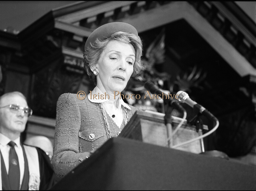 Nancy Reagan .Visits the Royal College Of Surgeons..St Stephens Green,.1984..04.06.1984.06.04.1984.4th June 1984..Nancy Reagan visited the Royal College of Surgeons where she unveilled a portrait of her late father.Her father, Dr Loyal Davis was an Honorary Fellow of the college. Mrs Reagan then presented the portrait to the college..Picture of Mrs Reagan as she gives a speech from the podium in the great hall at the Royal College of Surgeons.