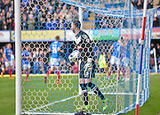 Notts County Goalkeeper Scott Loach picks the ball out of the net after Portsmouth defender Christian Burgess makes it 3-0 during the Sky Bet League 2 match between Portsmouth and Notts County at Fratton Park, Portsmouth, England on 25 March 2016. Photo by Adam Rivers.
