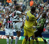 Photo: Rich Eaton.<br /> <br /> West Bromwich Albion v Leeds United. Coca Cola Championship. 30/09/2006. Martin Albrechtsen #14 left of West Brom scores the first goal of the game past Leeds goalkeeper Tony Warner and Geoff Horsfield