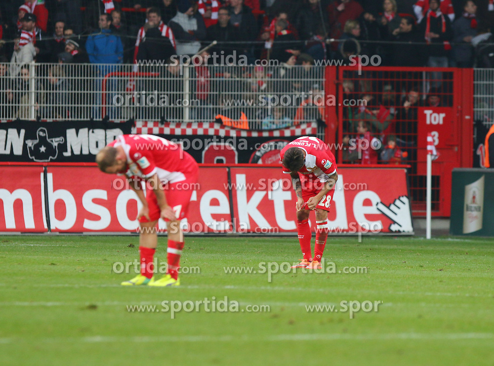 22.11.2014, Alte F&ouml;rsterei, Berlin, GER, 2. FBL, 1. FC Union Berlin vs TSV 1860 Muenchen, 14. Runde, im Bild Niedergeschlagenheit bei Maximilian Thiel (1. FC Union Berlin)und Christopher Trimmel (1. FC Union Berlin) nach der Niederlage // SPO during the 2nd German Bundesliga 14th round match between 1. FC Union Berlin and TSV 1860 Muenchen at the Alte F&ouml;rsterei in Berlin, Germany on 2014/11/22. EXPA Pictures &copy; 2014, PhotoCredit: EXPA/ Eibner-Pressefoto/ Hundt<br /> <br /> *****ATTENTION - OUT of GER*****