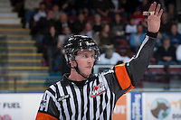 KELOWNA, CANADA - APRIL 3: Brett Iverson, referee, makes a call on the ice at the Kelowna Rockets against the Seattle Thunderbirds on April 3, 2014 during Game 1 of the second round of WHL Playoffs at Prospera Place in Kelowna, British Columbia, Canada.   (Photo by Marissa Baecker/Getty Images)  *** Local Caption *** Brett Iverson'