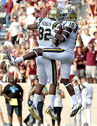UCLA wide receiver Kenneth Walker III (10) celebrates his 63 yard catch and run touchdown with teammate Eldridge Massington (82) against Texas A&M during the fourth quarter of an NCAA college football game Saturday, Sept. 3, 2016, in College Station, Texas. Texas A&M won 31-24 in overtime. (AP Photo/Sam Craft)