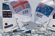 ENGLAND, Weymouth. 3rd August 2012. Olympic Games. Men's 470 Class. Luke Patience (GBR) Skipper, Stuart Bithell (GBR) Crew and Mathew Belcher (AUS) Skipper, Malcolm Page (AUS) Crew.