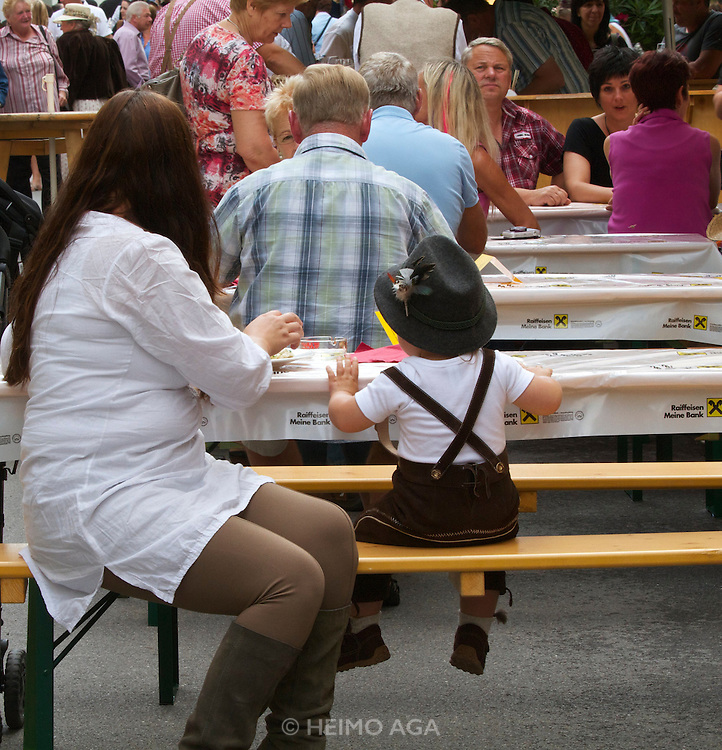 Kärntnernudelfest (Carinthian Dumplings Festival) in Oberdrauburg 2011. A little visitor having fun with his noodles.