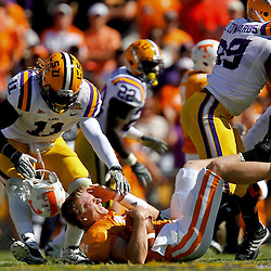Oct 2, 2010; Baton Rouge, LA, USA; LSU Tigers linebacker Kelvin Sheppard (11) sacks Tennessee Volunteers quarterback Matt Simms (2) ripping off his helmet on the play during the first half at Tiger Stadium.  Mandatory Credit: Derick E. Hingle
