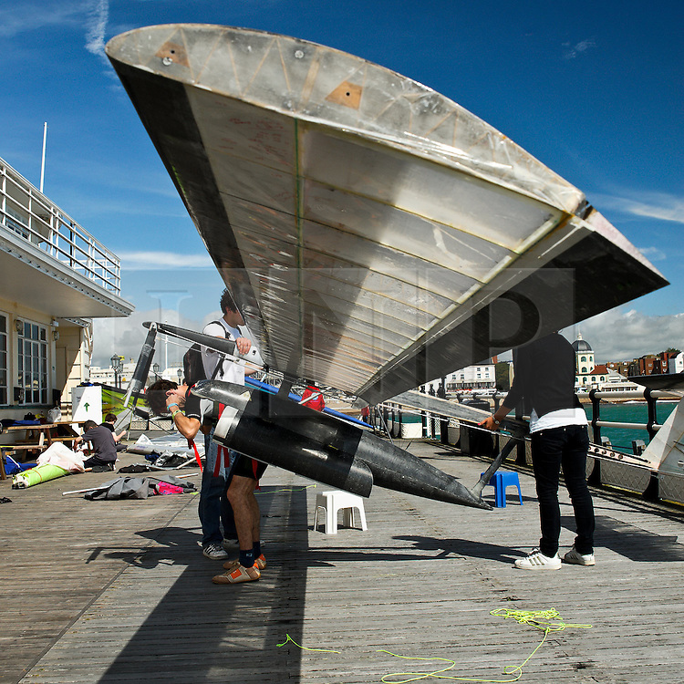© Licensed to London News Pictures. 13/08/2011. Worthing, UK. Dusan Vuletic from Serbia readies his craft before jumping from Worthing pier. The aim is to fly over 100M and win the £10,000 price for the longest flight. Flying was cancelled due to high winds. Sundays (14th) event will also include fun flyers raising money for charity.  Photo credit : Julie Edwards/LNP