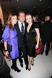 Left to right, LUCY YEOMANS, MARIO TESTINO and KATE WINSLET at a party to celebrate Lancome's 10th anniversary of sponsorship of the BAFTA's in association with Harper's Bazaar magazine held at St.Martin's Lane Hotel, London on 19th February 2010.