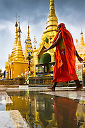 A Buddhist monk at Shwedegon Pagoda in Yangon, Myanmar (Burma).
