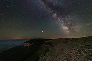 Mars and the milky way shine above the Pryor Mountains on a dark night.