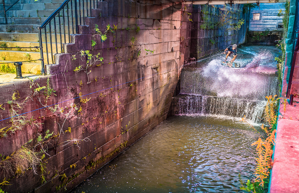 Brian Grubb performs on one of the original locks of the Erie Canal in Lockport, New York, USA on August 26th, 2014.
