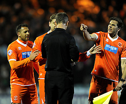 Blackpool's Dan Gosling and Blackpool's Steven Davies remonstrate with Referee, Christopher Sarginson on the final whistle - Photo mandatory by-line: Joe Meredith/JMP - Tel: Mobile: 07966 386802 03/12/2013 - SPORT - Football - Yeovil - Huish Park - Yeovil Town v Blackpool - Sky Bet Championship