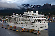 Port of Ushuaia, southernmost city in the world. Tierra del Fuego, Argentina. The World, a luxury floating condo ship.
