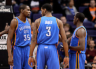 Jan. 14, 2013; Phoenix, AZ, USA; Oklahoma City Thunder forward Kevin Durant (35) , forward Perry Jones (3) and guard Reggie Jackson (15) talk on the court during the game against the Phoenix Suns at the US Airways Center. The Thunder defeated the Suns 102-90. Mandatory Credit: Jennifer Stewart-USA TODAY Sports