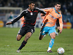 MARSEILLE, FRANCE - Tuesday, December 11, 2007: Liverpool's Ryan Babel and Olympique de Marseille's Julien Rodriguez during the final UEFA Champions League Group A match at the Stade Velodrome. (Photo by David Rawcliffe/Propaganda)