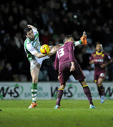 Watford's Mathias Ranegie battles for the high ball with Yeovil Town's Shane Duffy - Photo mandatory by-line: Joe Meredith/JMP - Tel: Mobile: 07966 386802 18/02/2014 - SPORT - FOOTBALL - Yeovil - Huish Park - Yeovil Town v Watford - Sky Bet Championship