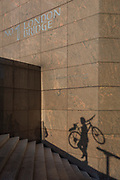 The shadow of a cyclist who has just carried his bike up the steps of 1, London Bridge in Southwark, on 10th October 2018, in London, England.