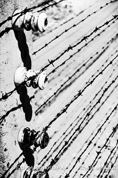 Graphic shot of electrified barbed wire fence at Auschwitz .Black and white.Poland.