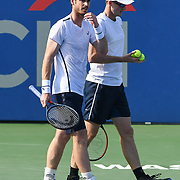 JAMIE MURRAY and ANDY MURRAY talk between points at the Rock Creek Tennis Center.