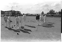 Shadows of men playing bowls, Bowling ground, Greenwich park, London street photography in 1982. Tri-X