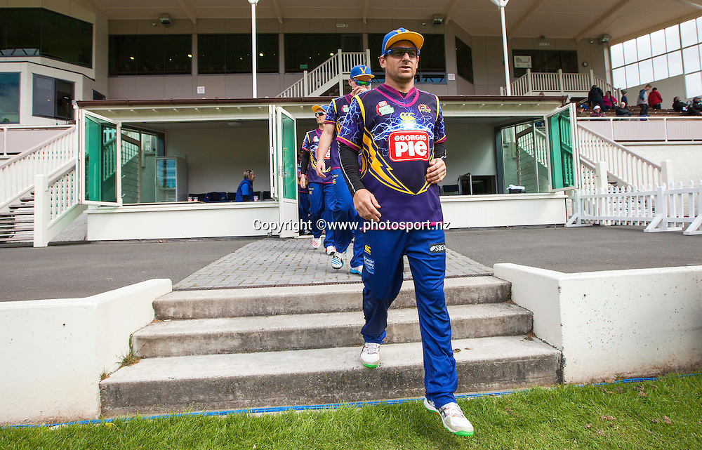 Nathan McCullum of the Otago Volts leads the team out onto the field before the Georgie Pie Super Smash Twenty20 cricket match between the Otago Volts v Northern Knights held at the University Oval, Dunedin. 17 November 2015. Photo: Joseph Johnson / www.photosport.nz