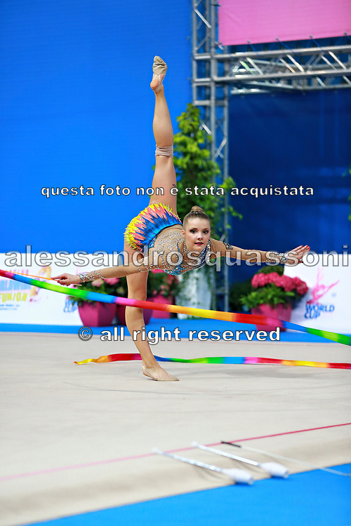 Jung Laura during qualifying at ribbon in Pesaro World Cup 11 April 2015. Laura is a German rhythmic gymnastics athlete born on June 25, 1995 in St. Wendel, Germany.