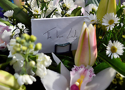 "© Licensed to London News Pictures. 08/04/2013. London, UK A label saying ""The Iron Lady"" Flowers left at the house where former Conservative Prime Minister Margaret Thatcher lived in central London. Lady Thatcher dies this mooring from a suspected stroke. Photo credit : Stephen Simpson/LNP"