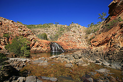 Croc Creek is a popular swimming spot on the Kimberley coast.  Saltwater lies under the inundation of freshwater from the waterfall.  Hundreds of boating tourists have contributed memorabilia over the years to a shack to the left of the pool.