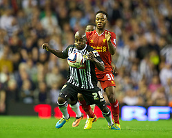 LIVERPOOL, ENGLAND - Tuesday, August 27, 2013: Liverpool's Raheem Sterling in action against Notts County's Jamal Campbell-Ryce during the Football League Cup 2nd Round match at Anfield. (Pic by David Rawcliffe/Propaganda)