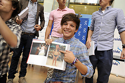 "© Licensed to London News Pictures. 15/09/2011.Lakeside,Essex, UK.One Direction at Lakeside,Essex to sign copies of their new book ""Dare to Dream"".  Liam, Harry, Zayn, Louis and Niall showed off the new book at   Lakeside's Central Atrium today (15.09.2011).Louis Tomlinson showing off his photo in the new book..Photo credit : Grant Falvey/LNP"