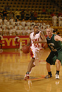 VMI's Reggie Williams drives past Southern Virginia's Tanner Johnson.