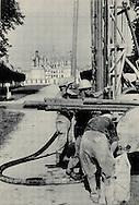 Drilling for oil in front of Chateau.<br /> <br /> <br /> Forage p&eacute;trolier dans le parc d'un Ch&acirc;teau