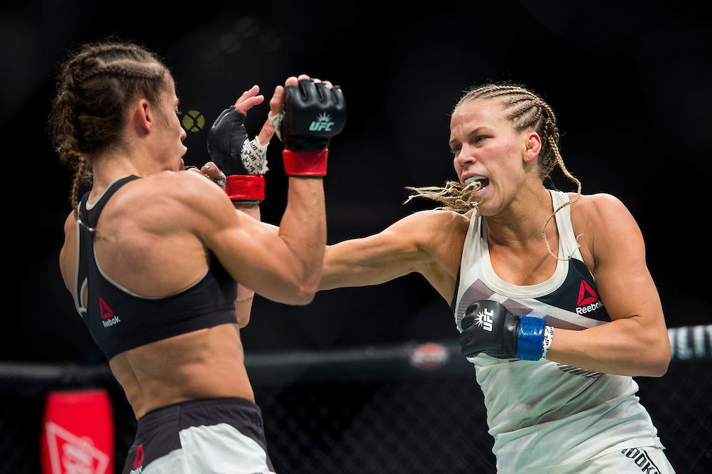Katlyn Chookagian connects with a punch against Liz Carmouche during UFC 205 at Madison Square Garden in New York, New York on November 12, 2016.  (Cooper Neill for The Players Tribune)