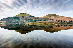 © Licensed to London News Pictures. 06/03/2020. Loweswater UK. The mountains that surround Loweswater lake in Cumbria reflect in the calm water this morning. Photo credit: Andrew McCaren/LNP